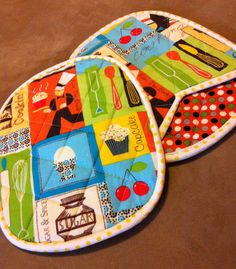 Kiss The Cook Pot Holder Mitts (Pair). $12.00, via Etsy.