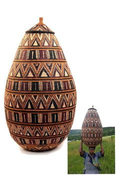 Africa   Very large 'Ukhamba' basket from Zululand, South Africa   Palm fronds wrapped around coils of wild grasses.  Natural dyes   This basket took nearly a year to create, in between time spent by the weaver tending to her fields