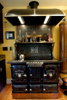 "Bruce Rosenbaum's ""totally modern stove housed in a gorgeous 1890s cast iron stove."""