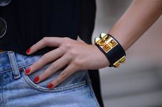 red nails, jean shorts, Hermes bracelet