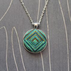 Minerva Cross stitch pendant necklace Emerald by TheWerkShoppe, $34.00