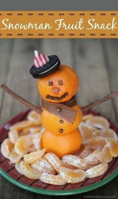 Snowman Fruit Snack - A fun winter snack or fruit platter for Christmas morning via momendeavors.com by farrahr