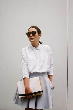 crisp white shirt, pleated skirt                                                                                                                                                                                 More