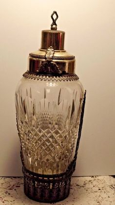 """ANTIQUE SILVER PLATE ITALY CRYSTAL COCKTAIL SHAKER  / 10 1/2"""". There is some wear to the plating but the crystal is perfect.  The base has 2 removable sections of filigree as does the ring at the top."""
