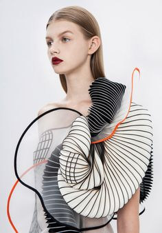Maybe not something I'd wear but still super cool. And bright orange accent. A Line of 3D Printed Clothing Based on Defects Photo