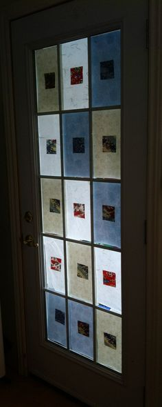 How to cover a glass door for privacy: cut squares of Japanese paper!