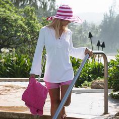 The breezy, fluid knit fabric of this hooded beach cover-up makes it easy to throw in your beach bag for everyday use. Get your cover-ups from UV Skinz.