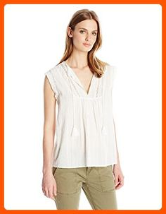 ba51804d6ddfc Sleeveless cotton top featuring split neckline with tassel-tipped ties.