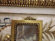"Detail of a cricket on the frame which is part of an arabesque panel representing ""Summer."" The Serilly Cabinet. Jones Collection."
