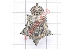 Indian Army. 24th Punjabis Officer's 1920 London hallmarked silver cap badge. Fine die-cast crown