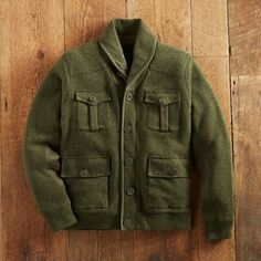 This handsome green sweater from Schott is a hybrid of the original WWII A-1 Military Mechanic Sweater and a classic military field jacket.