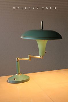 MID CENTURY  SWING ARM LAMP  ca. 1950  An early swing-arm lamp that features a saucer style shade and uses reflection to provide light to a working surface. This rare green color almost  glows like neon when the lamp is turned on.  Asking: $180 plus s/h