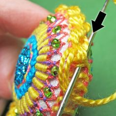 Learn how to make an adorable embroidered scissor fob with this FREE step-by-step tutorial from pro Mary Corbet.