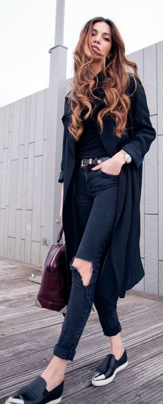 Via Just The Design: Negin Mirsalehi is wearing an oversized black coat with River Island skinny jeans and a pair of black Miu Miu pumps