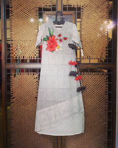 This cotton grey stripes and checks dress is having applique flower motifs with angrakha style along with the printed hangings. Kurta Designs Women, Kurti Neck Designs, Dress Neck Designs, Kurti Designs Party Wear, Blouse Designs, Kurti Embroidery Design, White Embroidery, Modern Embroidery, Plain Kurti