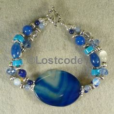 'Blue Agate two strand bracelet' is going up for auction at  9am Tue, Jul 10 with a starting bid of $12.