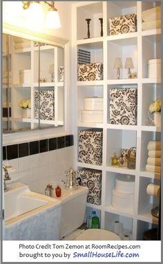 Small Bathroom: Black and white bathroom with amazing storage idea. SmallHouseLife.com