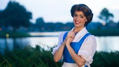 Belle stands by the World Showcase Lagoon clasping her hands at Meet Belle in France