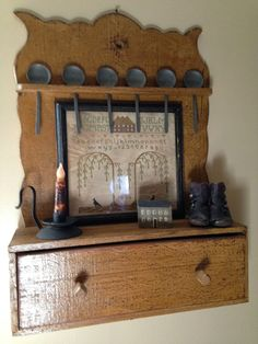 Just love this spoon rack with the pewter spoons.