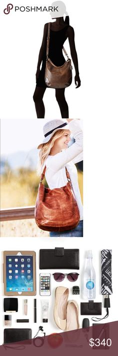 Frye Melissa Hobo Bag In Dark Brown The Frye Melissa Hobo has a rich leather construction and streamline organization that will make it your ideal everyday bag. Please note: Melissa Hobo may not come with a Frye metal tag as Frye is phasing out the tag in their bag production. Antique pull up leather hobo. Leather shoulder strap and an adjustable leather crossbody strap. Printed fabric lining with a back wall zipper pocket and two multifunctional pockets. Magnetic button closure. Frye Bags…