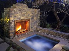 Backyard fireplace with a hot tub