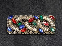 Hey, I found this really awesome Etsy listing at http://www.etsy.com/listing/172807693/antique-rhinestone-brooch-pin-victorian