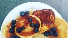 Healthy pancakes with a bit maple syrup and blueberries