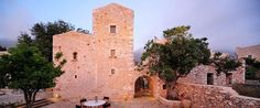 Citta dei Nicliani is housed in a listed, tower-house in Kitta of Eastern Mani. Greece Hotels, Tower House, Patio, Mansions, House Styles, Outdoor Decor, Home, Travel, Manor Houses