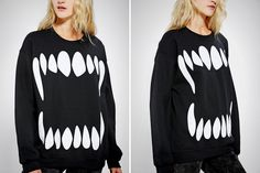 Want to dress up as a vampire without piling on pale makeup? Try this fang sweatshirt on for size.