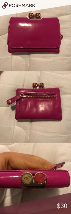 Ted Baker wallet Hot pink Ted Baker wallet with gray interior and floral pocket print. Expandable coin purse can also be used when wallet is open. Patent leather and exterior is in good condition. Minor damage to gray interior (pictured). Great wallet! Ted Baker Bags Wallets