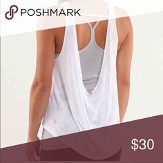 LULULEMON tank PRELOVED. Shoes some signs of wear in the material but still lots of room for love and a new owner!!! lululemon athletica Tops Tank Tops
