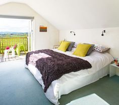 Eily Roe and Connor Kennedy added a double-height extension to the rear of their country cottage without the need of planning permission. Taking advantage of their sloping garden, the couple created an open-plan lower ground floor