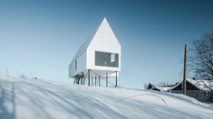 Delordinaire raises High House above snowy Quebec countryside to protect an outdoor lounge