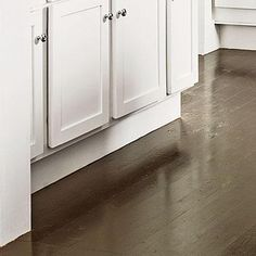 Painted Floors | Two coats of paint specially formulated for floors plus one coat of polyurethane create an extra-durable, low-maintenance finish on lower-grade pine floors. | SouthernLiving.com