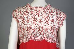 Back detail of red cotton pique trapeze dress with lace bodice, Geoffrey Beene, ca. 1987, KSUM 2015.2.6.
