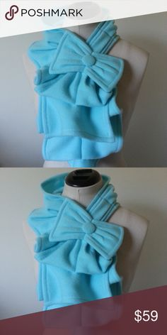 Teal Fleece Ruffle Scarf with Bow Detail Stunning and unique fleece ruffle scarf with bow. Put this scarf around your neck and simply put the button thru the loop.  The design is beautiful with a coat, denim jacket or a blouse. Accessories Scarves & Wraps
