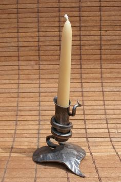 Cute little hand forged candle holder! Visit stonecountyironworks.com for more amazing wrought iron designs!