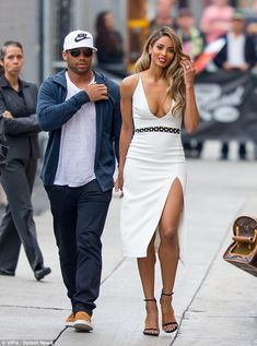 Making a splash: NFL star Russell Wilson had earlier accompanied his wife to be as she filmed Jimmy Kimmel in Hollywood