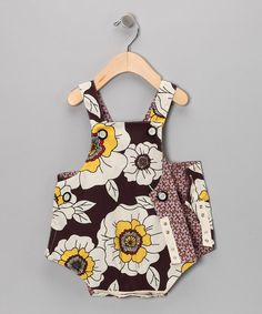 This fun bodysuit is two outfits in one! Just flip it inside out to show off another vibrant pattern. Buttons and snaps make changing easy, while lightweight, airy fabric keeps little ones cool and comfy.65% polyester / 35% cottonMachine washMade in the USA