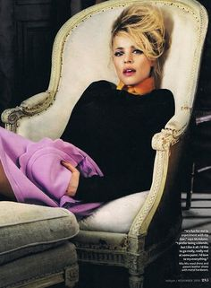 This is one of my favorite shots of Rachel McAdams. The lilac skirt softens the black sweater and preppy orange collar.