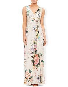 Crafted from soft, form-flattering jersey, our Lara maxi dress is printed with flowers in beautiful colours. The wrap-over, v-shaped neckline flatters the bust, while the ruched waist accentuates the narrowest part of your silhouette.  Model wears UK 8/UK S/EU 36/US 4. Model height is 175 cm/5'9.