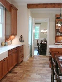Kitchen Photos French Terra Cotta Tile Flooring--I like this floor w/ the wood color