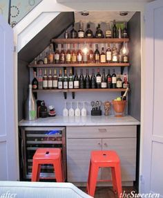 Bar in a cupboard underneath the stairs- very clever...
