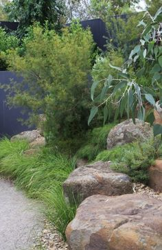Planting around boulders also work as occasional seating