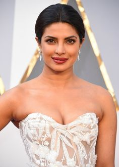 There was one major thing we couldn't take our eyes off of when Priyanka Chopra showed up on the red carpet at the Oscars. Yes, the 33-year-old presenter's plum lip color was amazing, and her bronze eyeshadow was killer....