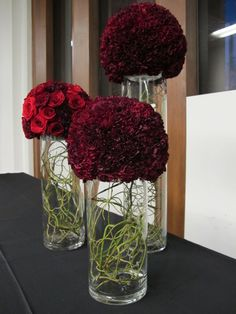 Carnation and rose balls for a corporate holiday event. Modern flower arrangements on the bar.