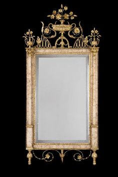 A Pair of Spanish Neoclassical Gilt-Gesso and Pink Marble Bilbao Wall Mirrors NORTH WEST SPAIN, circa 1800-09