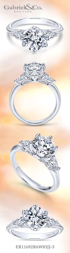 Gabriel & Co. - Voted #1 Most Preferred Bridal Brand.   This three (3) stone engagement ring featuring a round cut center stone and two accent diamonds is reminiscent of a twinkling starburst.