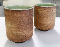 Some of Corey's new wheel thrown rustic tall tea bowls.   #clay #ceramics #ceramicist #ceramicart #ceramicartist #ceramica #pottery #potter #art #artist #glaze #design #stoneware #homewares #teacups #teabowls #contemporaryceramics #wheelthrown #wheelthrownpottery #wheelthrownceramics #australianceramics #australianmade #handmadeinaustralia #australiandesign #green #rustic #rustichome #speckled #whimsical #chantalandcorey
