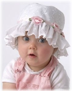 little pink roses on her little lace hat